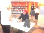 Signing his book, Ned Kelly, at Carindale Library.